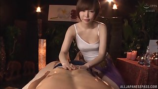 Short haired Japanese Satomi Yuria massages a blarney with her pussy