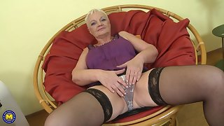 Short haired mature amateur blonde Anna C. stuffs her pussy with toys