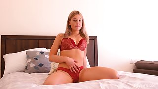 Blonde busty solo model Serena stuffs her holes with toys