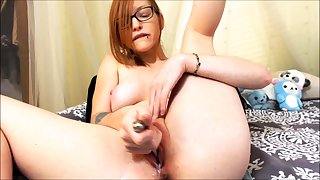 Solo redhead slut toys and fingers her holes